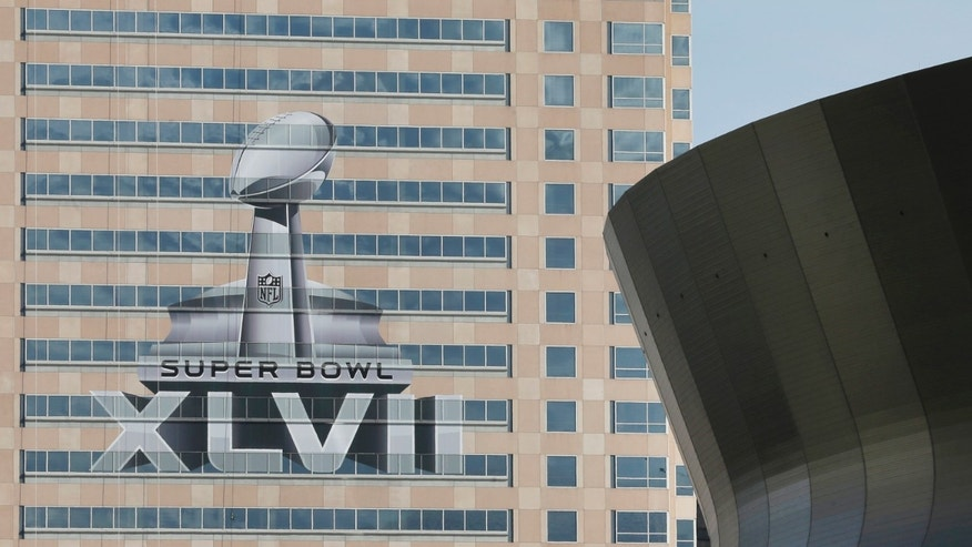 Jan. 27, 2013: The NFL Super Bowl XLVII NFL football game logo is seen past the Mercedes-Benz Superdome on the face of an office building as preparations take place.