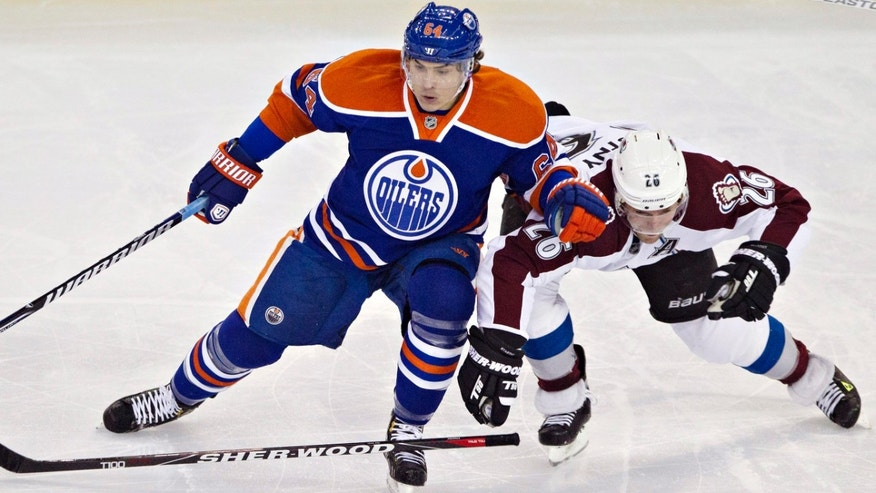 Edmonton Oilers' Nail Yakupov, left, battles for the puck with Colorado Avalanche's Paul Stastnyduring the second period of their NHL hockey game, Monday, Jan. 28, 2013, in Edmonton, Alberta. (AP Photo/The Canadian Press, Jason Franson)