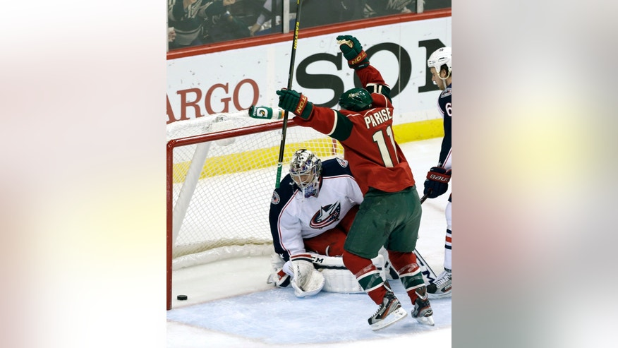 Minnesota Wild's Zach Parise, right, celebrates a goal by Mikko Koivu on a shot off Columbus Blue Jackets goalie Steve Mason, left, in the first period of an NHL hockey game Tuesday, Jan. 29, 2013 in Saint Paul, Minn. (AP Photo/Jim Mone)