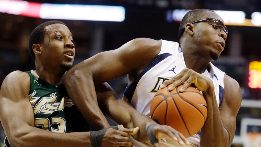 Marquette's Chris Otule, right, grabs a rebound away from South Florida's Kore White, left, during the second half of an NCAA college basketball game, Monday, Jan. 28, 2013, in Milwaukee. (AP Photo/Jeffrey Phelps)