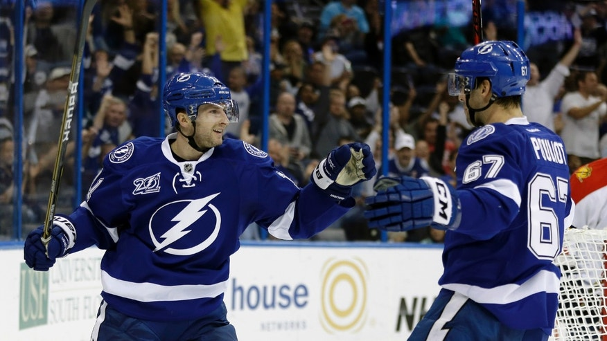 Tampa Bay Lightning center Tom Pyatt, left, celebrates with teammate Benoit Pouliot (67) after scoring against the Florida Panthers during the second period of an NHL hockey game Tuesday, Jan. 29, 2013, in Tampa, Fla. (AP Photo/Chris O'Meara)