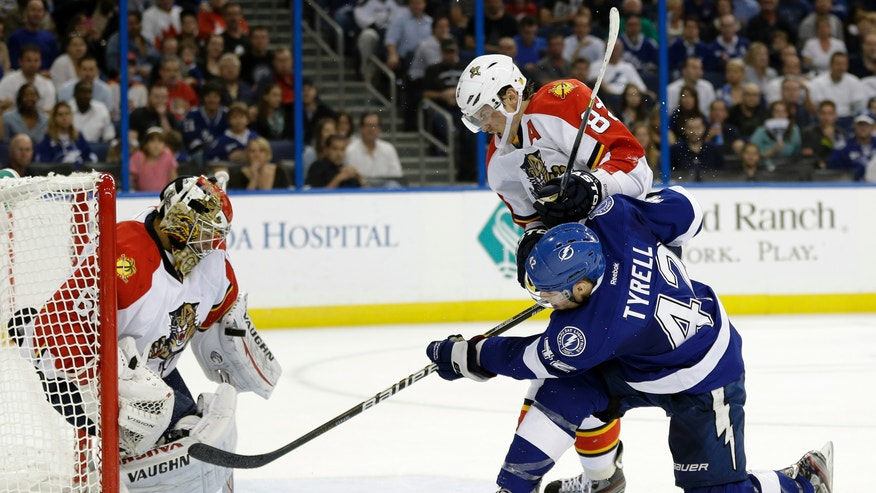 Tampa Bay Lightning center Dana Tyrell (42) shoots past Florida Panthers goalie Jose Theodore (60) as Panthers center Tomas Kopecky (82), of Slovakia, trails during the second period of an NHL hockey game Tuesday, Jan. 29, 2013, in Tampa, Fla. (AP Photo/Chris O'Meara)
