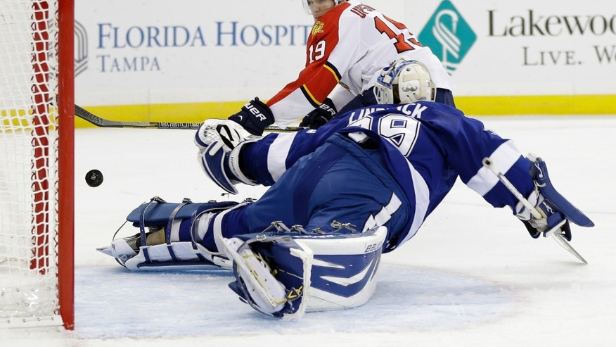 Tampa Bay Lightning goalie Anders Lindback (39), of Sweden, makes a diving save on a shot by Florida Panthers right wing Scottie Upshall (19) during the first period of an NHL hockey game Tuesday, Jan. 29, 2013, in Tampa, Fla. (AP Photo/Chris O'Meara)