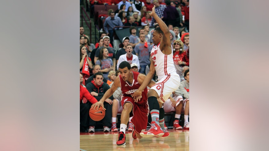 Wisconsin's Traevon Jackson, left, drives the baseline against Ohio State's Lenzelle Smith during the first half of an NCAA college basketball game Tuesday, Jan. 29, 2013, in Columbus, Ohio. (AP Photo/Jay LaPrete)