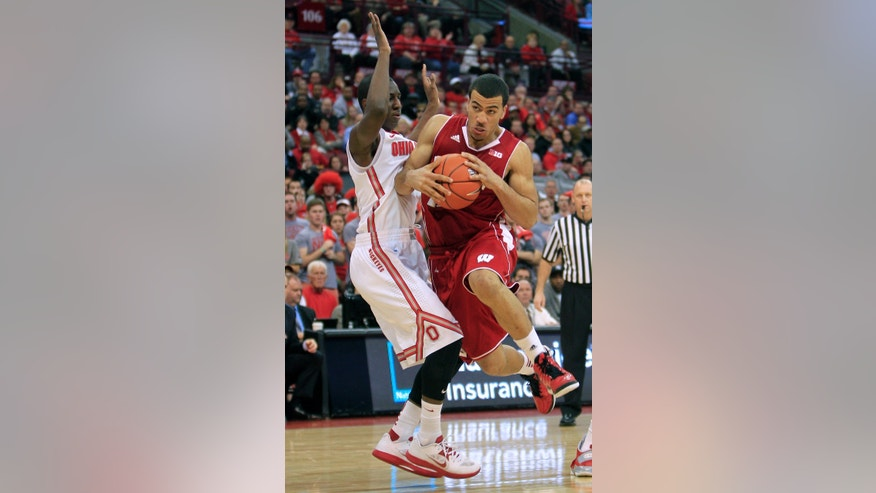 Wisconsin's Traevon Jackson, right, drives to the basket against Ohio State's Shannon Scott during the first half of an NCAA college basketball game Tuesday, Jan. 29, 2013, in Columbus, Ohio. (AP Photo/Jay LaPrete)