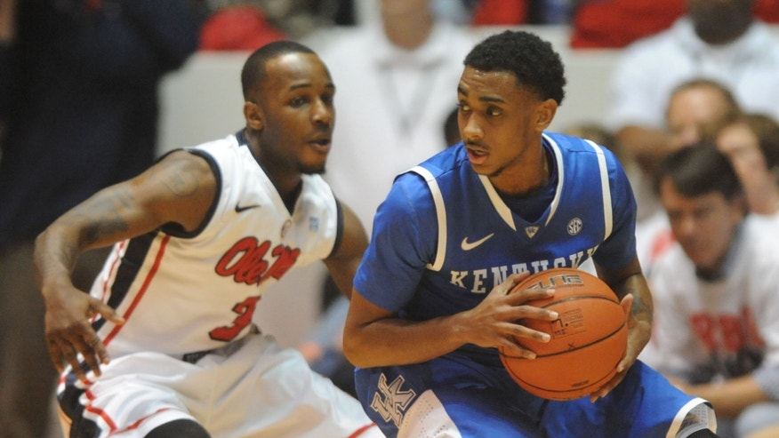 Kentucky's Ryan Harrow (12) works against Mississippi's Derrick Millinghaus (3) during an NCAA college basketball game Tuesday, Jan. 29, 2013, in Oxford, Miss. (AP Photo/Oxford Eagle, Bruce Newman) MANDATORY CREDIT  MAGS OUT  NO SALES