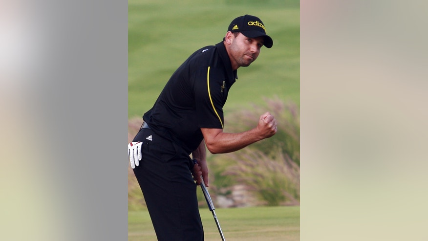 Spain's Sergio Garcia gestures during the final round of the Qatar Masters Golf Tournament in the capital Doha, Qatar, Saturday, Jan. 26, 2013. (AP Photo/Osama Faisal)