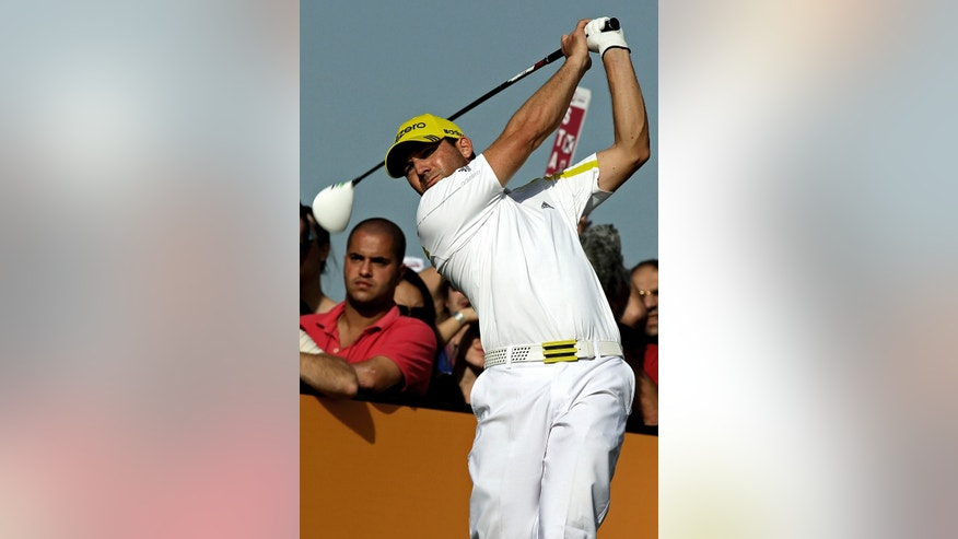 Spain's Sergio Garcia plays his shot on the 15th hole during the third round of the Commercial Bank Qatar Masters held at the Doha Golf Club in Qatar, Friday, Jan. 25, 2013. (AP Photo/Osama Faisal)