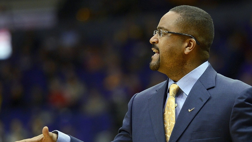 Missouri head coach Frank Haith shouts instructions to his players during the first half of an NCAA college basketball game against LSU  at the Pete Maravich Assembly Center in Baton Rouge, La., Wednesday, Jan. 30, 2013. (AP Photo/Bill Feig)