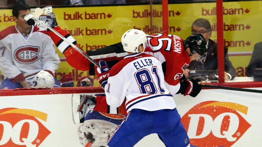 Montreal Canadiens' Lars Eller (81) checks Ottawa Senators' Daniel Alfredsson along the boards during first period NHL hockey action in Ottawa, Wednesday, Jan. 30, 2013. (AP Photo/The Canadian Press, Fred Chartrand)
