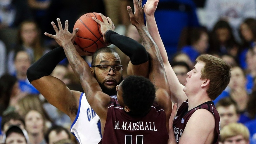 Creighton's Gregory Echenique is trapped by Missouri State's Marcus Marshall (11) and Nathan Scheer, right, in the first half of an NCAA college basketball game in Omaha, Neb., Wednesday, Jan. 30, 2013. (AP Photo/Nati Harnik)
