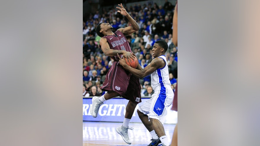 Missouri State's Marcus Marshall, left, loses to ball to Creighton's Andre Yates, in the first half of an NCAA college basketball game in Omaha, Neb., Wednesday, Jan. 30, 2013. (AP Photo/Nati Harnik)
