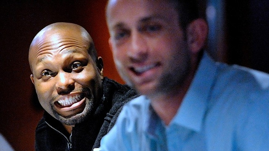 Torii Hunter, left, mugs for the camera during a Jan. 26 autograph session in Detroit. Hunter, 37, said last year he moved to Texas because of the state's lack of income tax. (AP)