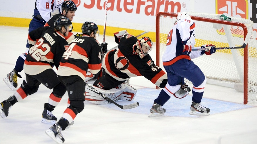 Ottawa Senators goaltender Craig Anderson makes a save as Washington Capitals' Nicklas Backstrom attempts to score during the first period of an NHL hockey game at the Scotia Bank Place in Ottawa, Ontario, on Tuesday, Jan. 29, 2013. (AP Photo/The Canadian Press, Sean Kilpatrick)