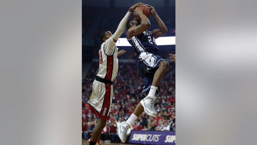 UNLV's Mike Moser (43) blocks a shot by Nevada's Deonte Burton in the first half of an NCAA college basketball game, Tuesday, Jan. 29, 2013, in Las Vegas. (AP Photo/Julie Jacobson)