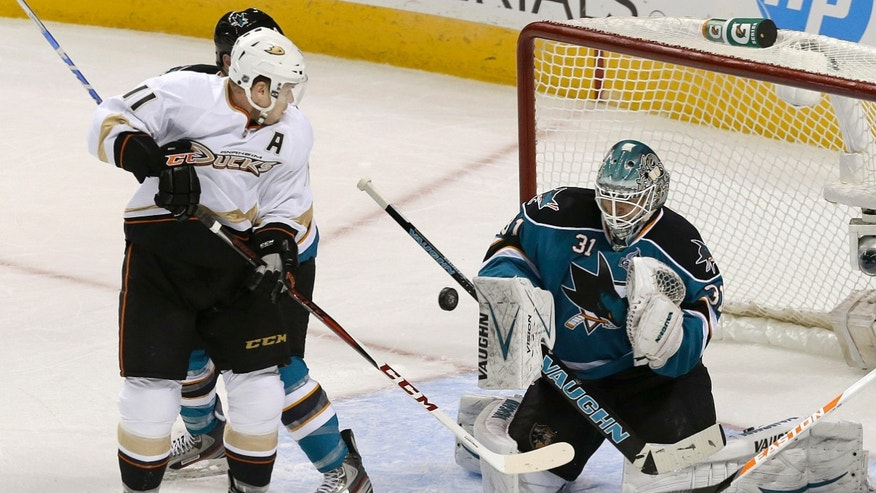 San Jose Sharks goalie Antti Niemi (31) blocks a shot by Anaheim Ducks center Saku Koivu (11) during the first period of an NHL hockey game in San Jose, Calif., Tuesday, Jan. 29, 2013. (AP Photo/Jeff Chiu)