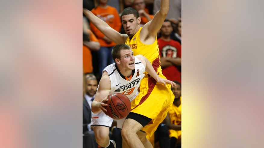 Oklahoma State guard Phil Forte (10) drives around Iowa State forward Georges Niang during the first half of an NCAA college basketball game in Stillwater, Okla., Wednesday, Jan. 30, 2013. (AP Photo/Sue Ogrocki)