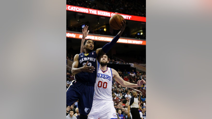 Memphis Grizzlies' Rudy Gay, left, drives to the basket past Philadelphia 76ers' Spencer Hawes (00) during the first half of an NBA basketball game, Monday, Jan. 28, 2013, in Philadelphia. (AP Photo/Matt Slocum)