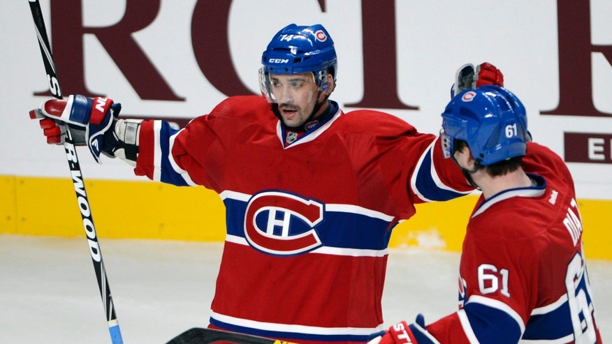 Montreal Canadiens center Tomas Plekanec (14) celebrates with defenseman Raphael Diaz (61) after scoring against the Winnipeg Jets during the third period of an NHL hockey game Tuesday, Jan. 29, 2013, in Montreal. (AP Photo/The Canadian Press, Ryan Remiorz)