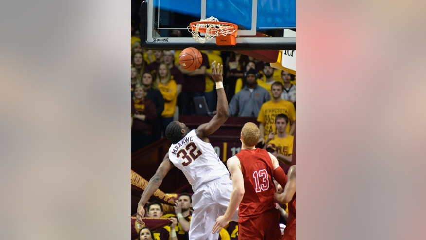 Minnesota's Trevor Mbakwe (32) dunks after getting behind Nebraska's Brandon Ubel (13) during the first half of an NCAA college basketball game, Tuesday, Jan. 29, 2013, in Minneapolis. (AP Photo/Tom Olmscheid)