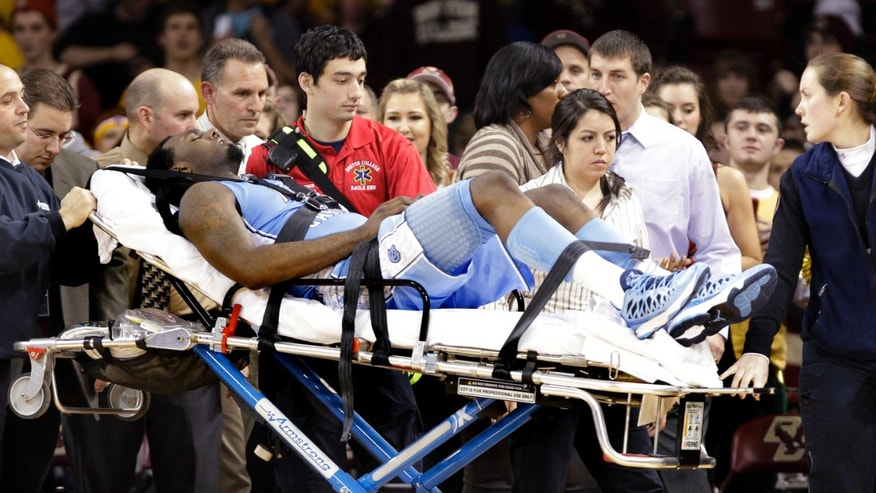 North Carolina's P.J. Hairston is taken off the court on a stretcher during the first half of an NCAA college basketball game against Boston College in Boston, Tuesday, Jan. 29, 2013. (AP Photo/Mary Schwalm)