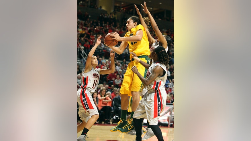 Baylor's Brittney Griner grabs a rebound away from Texas Tech's Casey Morris (15), Jackie Patterson, back, and Chynna Brown, right, during an NCAA college basketball game in Lubbock, Texas, Wednesday, Jan. 30, 2013. (AP Photo/Zach Long)