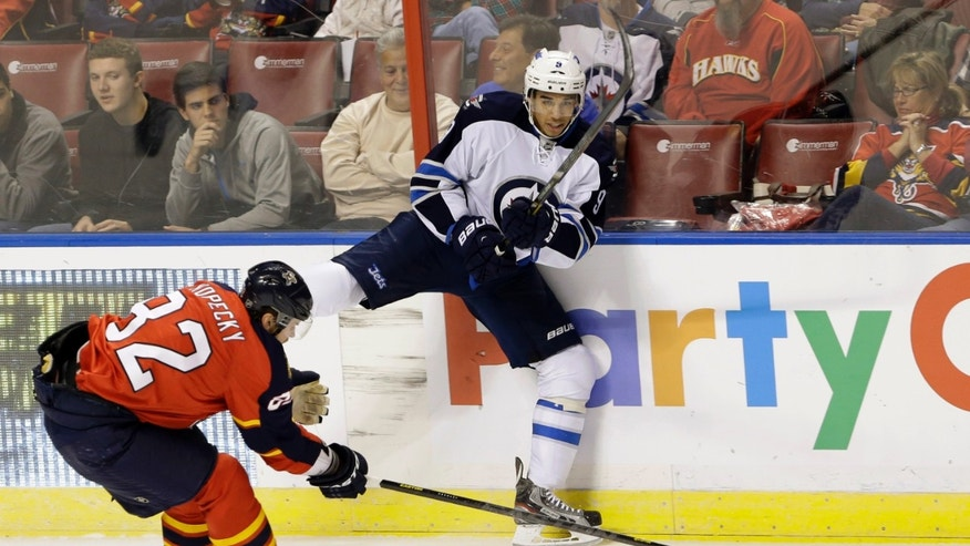 Winnipeg Jets left wing Evander Kane (9), of Canada, passes past Florida Panthers right wing Kris Versteeg (32), also of Canada, during the first period of an NHL hockey game, Thursday, Jan. 31, 2013, in Sunrise, Fla. (AP Photo/Wilfredo Lee)