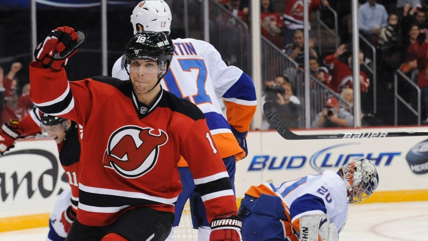 New Jersey Devils' Steve Bernier celebrates his goal against New York Islanders goaltender Evgeni Nabokov, right, during the second period of an NHL hockey game Thursday, Jan. 31, 2013, in Newark, N.J. (AP Photo/Bill Kostroun)