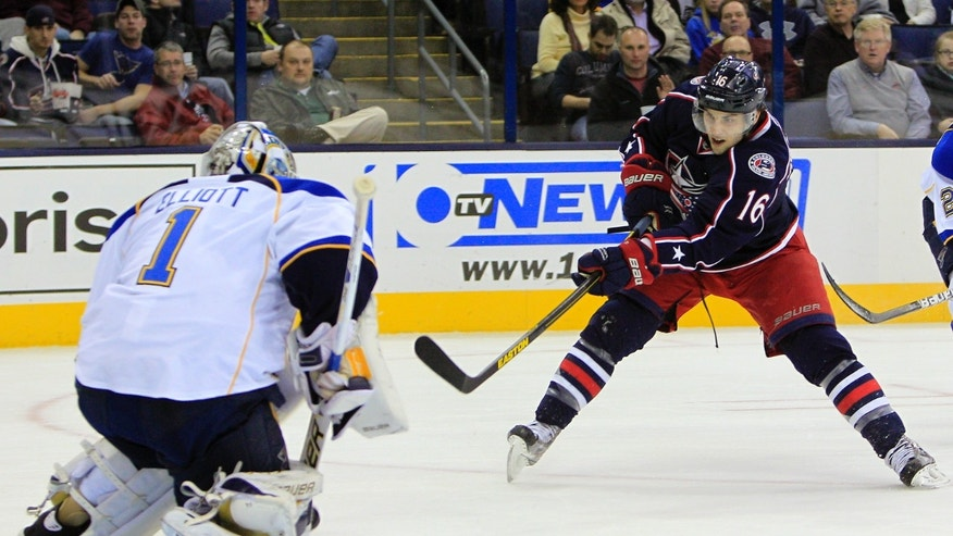 Columbus Blue Jackets' Derick Brassard, right, takes a shot against St. Louis Blues' Brian Elliott during the second period of an NHL hockey game Thursday, Jan. 31, 2013, in Columbus, Ohio. (AP Photo/Jay LaPrete)