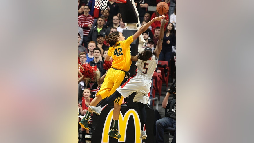 Texas Tech's Christine Hyde, right,  shoots against Baylor's Brittney Griner during an NCAA college basketball game in Lubbock, Texas, Wednesday, Jan. 30, 2013. (AP Photo/Zach Long)