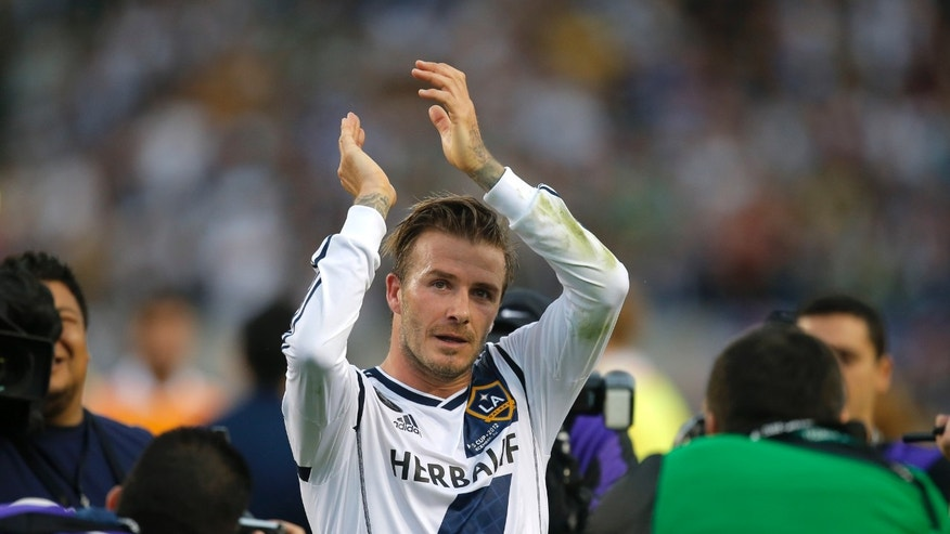 FILE - In this Saturday, Dec. 1, 2012 file photo Los Angeles Galaxy's David Beckham, of England, acknowledges the fans as he leaves the field after the team's 3-1 win in the MLS Cup championship soccer match against the Houston Dynamo in Carson, Calif.  According to reports Thursday Jan. 31, 2013, David Beckham is to join Paris Saint-Germain.  (AP Photo/Jae C. Hong, File)