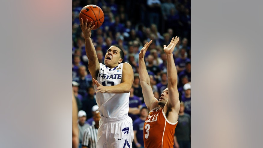 Kansas State guard Angel Rodriguez (13) gets past Texas guard Javan Felix (3) for a basket during the second half of an NCAA college basketball game in Manhattan, Kan., Wednesday, Jan. 30, 2013. Kansas State defeated Texas 83-57. (AP Photo/Orlin Wagner)