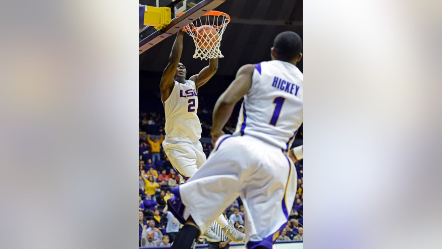 LSU forward Johnny O'Bryant III (2) dunks on an alley-oop from teammate Anthony Hickey (1) during the first half of an NCAA college basketball game against Missouri at the Pete Maravich Assembly Center in Baton Rouge, La., Wednesday, Jan. 30, 2013. (AP Photo/Bill Feig)