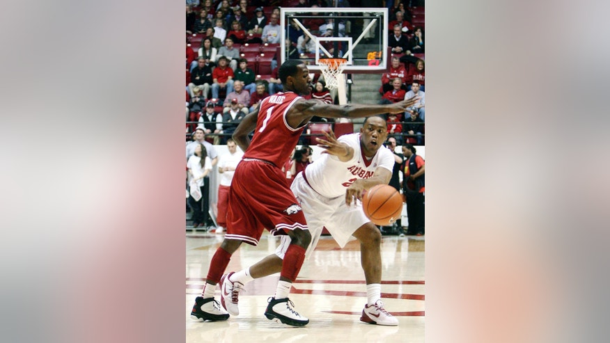 Alabama guard Andrew Steele (22) passes to a teammate around Arkansas guard Mardracus Wade (1) during their NCAA college basketball game, Thursday, Jan. 31, 2013, in Tuscaloosa, Ala.  (AP Photo/Tuscaloosa News, Michelle Lepianka Carter)