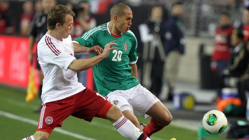 Mexico defenseman Jorge Torres Nilo (20), right, battles with Denmark mid-fielder Emil Larsen (10) during the first half of an international friendly soccer match on Wednesday, Jan. 30, 2013, in Glendale, Ariz. (AP Photo/Rick Scuteri)