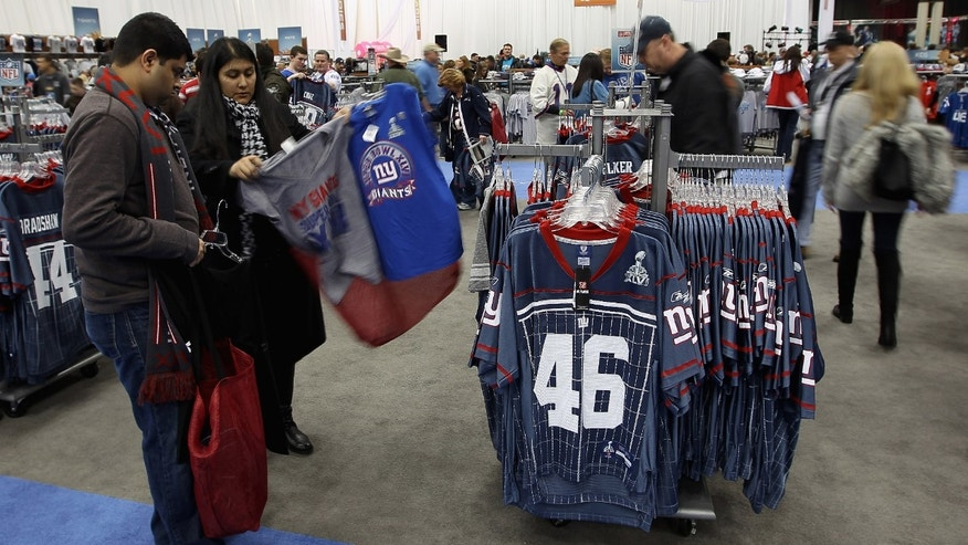 INDIANAPOLIS, IN - FEBRUARY 04:  Merchandise for sale is seen at the at the Super Bowl XLVI NFL Experience at the Indiana Convention Center on February 4, 2012 in Indianapolis, Indiana. The New England Patriots will play the New York Giants in Super Bowl XLVI on February 5, 2011 at Lucas Oil Stadium in Indianapolis, Indiana.  (Photo by Ezra Shaw/Getty Images)