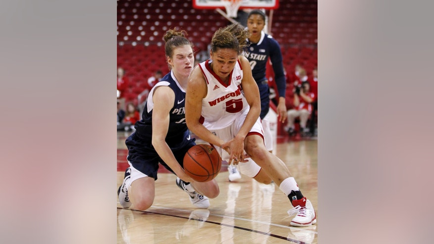Penn State's Maggie Lucas, left, and Wisconsin's Morgan Paige go after a loose ball during the second half of an NCAA college basketball game Thursday, Jan. 31, 2013, in Madison, Wis. Wisconsin won 63-61. (AP Photo/Andy Manis)