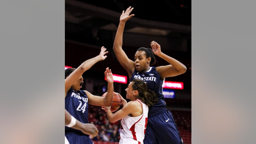 Wisconsin's Morgan Paige, center, goes up against Penn State's Mia Nickson, left, and Talia East during the second half of an NCAA college basketball game Thursday, Jan. 31, 2013, in Madison, Wis. Paige had a game-high 33 points win Wisconsin's 63-61 win. (AP Photo/Andy Manis)