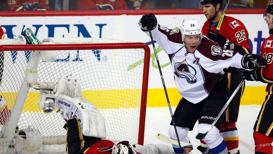 Colorado Avalanche's Paul Stastny, right, celebrates scoring against Calgary Flames goalie Miikka Kiprusoff during the third period of an NHL hockey game Thursday, Jan. 31, 2013, in Calgary, Alberta. The Avalanche won 6-3. (AP Photo/The Canadian Press, Jeff McIntosh)