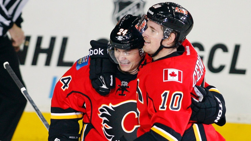 Calgary Flames' Jiri Hudler, left, celebrates his second goal against the Colorado Avalanche with teammate Roman Cervenka during the second period of an NHL hockey game Thursday, Jan. 31, 2013, in Calgary, Alberta. (AP Photo/The Canadian Press, Jeff McIntosh)