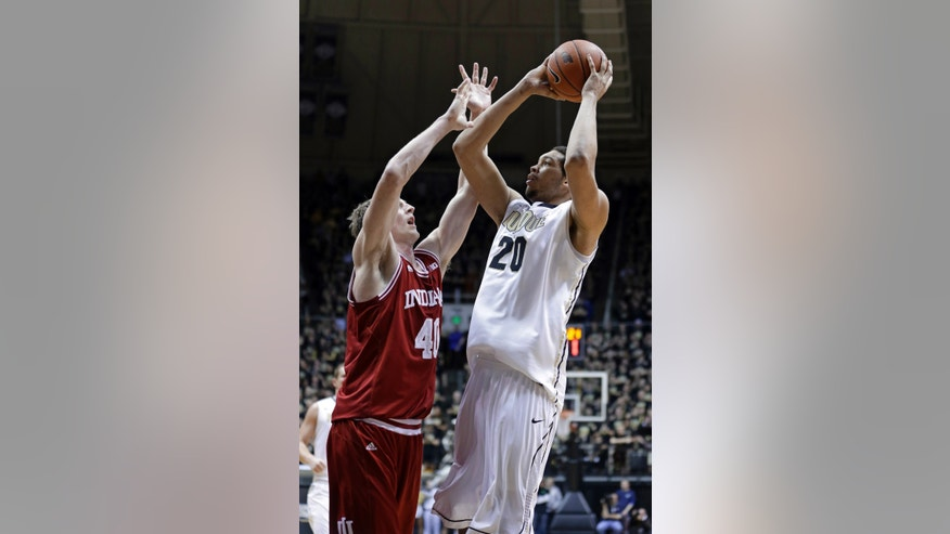 Purdue center A.J. Hammons, right, shoots over Indiana forward Cody Zeller in the second half of an NCAA college basketball game in West Lafayette, Ind., Wednesday, Jan. 30, 2013. Indiana defeated Purdue 97-60. (AP Photo/Michael Conroy)