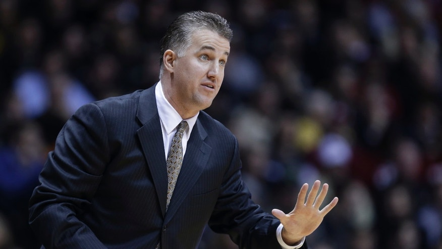 Purdue coach Matt Painter calls a play against Indiana in the first half of an NCAA college basketball game in West Lafayette, Ind., Wednesday, Jan. 30, 2013. (AP Photo/Michael Conroy)