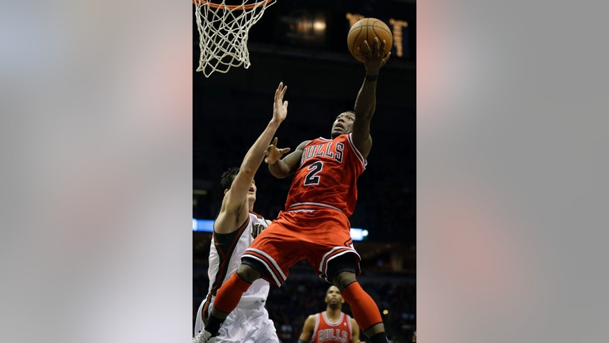 Chicago Bulls' Nate Robinson (2) puts up a shot against Milwaukee Ersan Ilyasova, left, during the first half of an NBA basketball game Wednesday, Jan. 30, 2013, in Milwaukee. (AP Photo/Jeffrey Phelps)