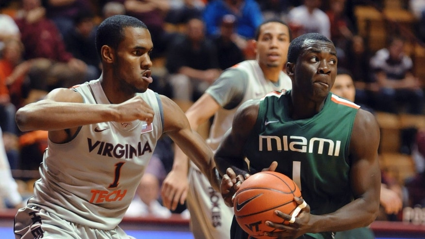 Miami's Durand Scott, right, keeps the ball from Virginia Tech's Robert Brown during the first half of an NCAA college basketball game Wednesday, Jan. 30, 2013, at Cassell Coliseum in Blacksburg, Va. (AP Photo/Don Petersen)