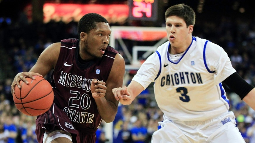 Missouri State's Gavin Thurman (20) drives to the basket against Creighton's Doug McDermott in the first half of an NCAA college basketball game in Omaha, Neb., Wednesday, Jan. 30, 2013. (AP Photo/Nati Harnik)