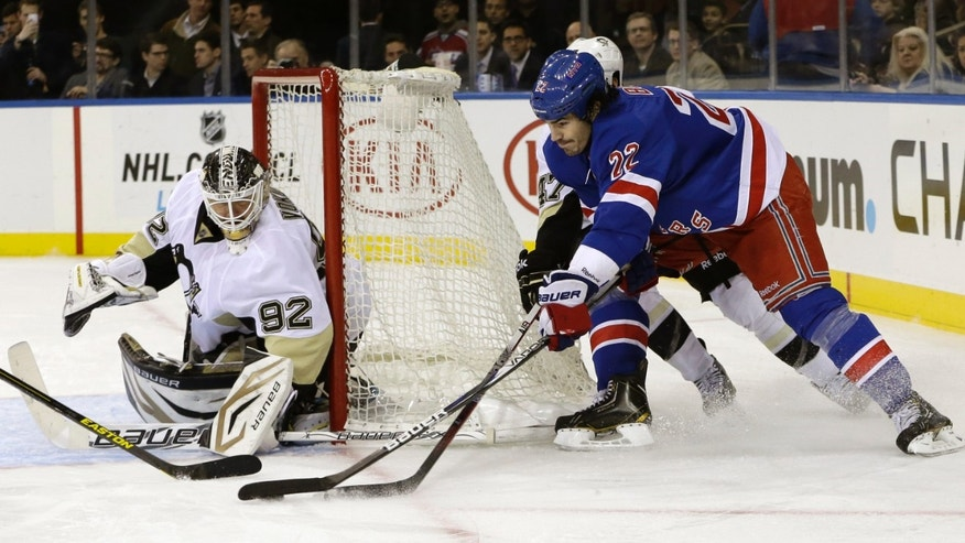 New York Rangers center Brian Boyle (22) skates near Pittsburgh Penguins goalie Tomas Vokoun (92), of Czech Republic, during the second period of their NHL hockey game in New York, Thursday, Jan. 31, 2013.  (AP Photo/Kathy Willens
