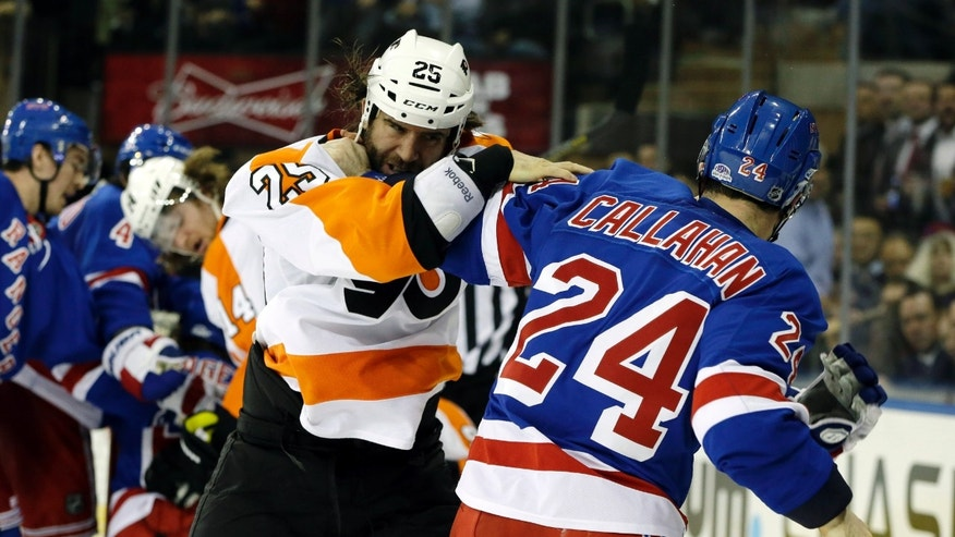New York Rangers right wing Ryan Callahan (24) and Philadelphia Flyers center Maxime Talbot (25), of Canada, fight in the third period of their NHL hockey game at Madison Square Garden in New York, Tuesday, Jan. 29, 2013. The Rangers defeated the Flyers 2-1. Callahan appeared to have been injured during the fight. (AP Photo/Kathy Willens)