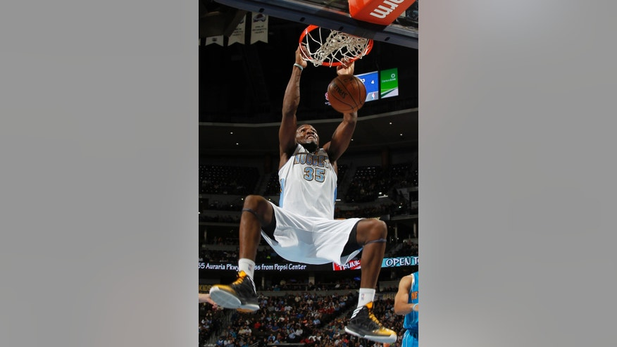 Denver Nuggets forward Kenneth Faried dunks a basket against the New Orleans Hornets in the first quarter of an NBA basketball game in Denver, Friday, Feb. 1, 2013. (AP Photo/David Zalubowski)