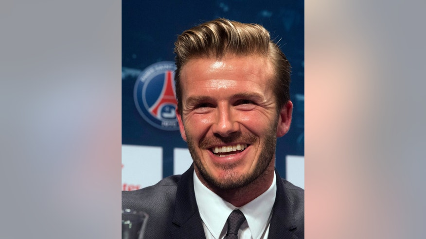 British soccer player David Beckham, smiles during a press conference, in at the Parc des Princes stadium in Paris, Thursday, Jan. 31, 2013. Beckham will join Paris Saint-Germain on Thursday, opting for a move to France after mulling over lucrative offers from around the world since leaving the Los Angeles Galaxy.(AP Photo/Michel Euler)