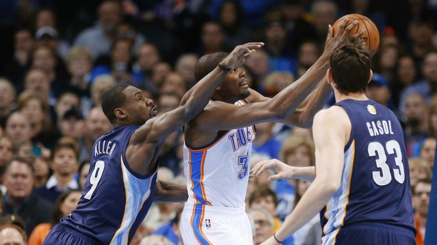 Oklahoma City Thunder forward Kevin Durant (35) is fouled by Memphis Grizzlies guard Tony Allen (9) as he shoots in front of center Marc Gasol during the first quarter of an NBA basketball game in Oklahoma City, Thursday, Jan. 31, 2013. (AP Photo/Sue Ogrocki)